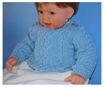 Customised Version of Patons Baby Aran Knitting Pattern knitted in blue 4 Ply