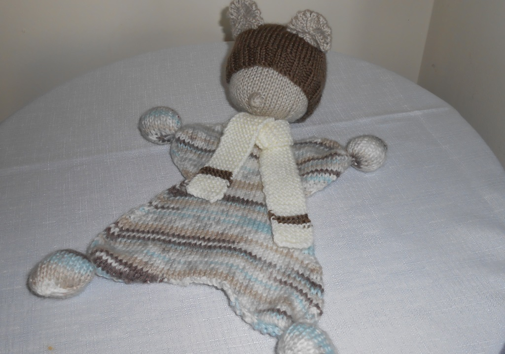Hand knitted waldorf doll using double knitting method